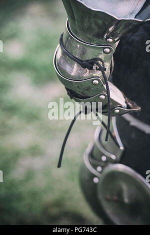 Detail of a member of a reenactment society wearing medieval armour - Stock Image