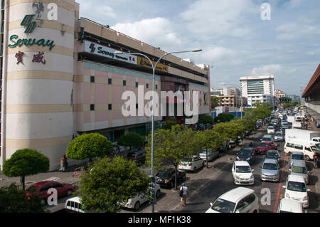 City centre streetscape, looking south from the Central Market walkway, Kota Kinabalu, Sabah, Malaysian Borneo - Stock Image