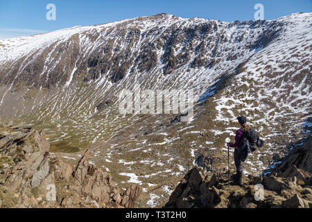 A solo female hiker looking towards the Summit os Snowdon in the Snowdonia National Park in Wales. Taken on the Rhyd Ddu path. - Stock Image
