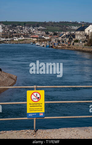 No jumping or tombstoning sign.The river Axe as it reaches the sea between Axmouth and Seaton. - Stock Image