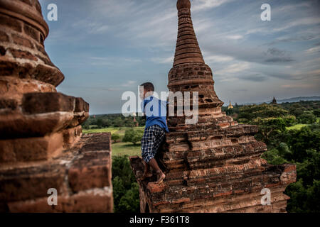 Children play on a temple in Bagan, Myanmar. - Stock Image