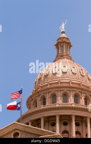 US and Texas flags flying over Texas State Capitol building Austin USA - Stock Image
