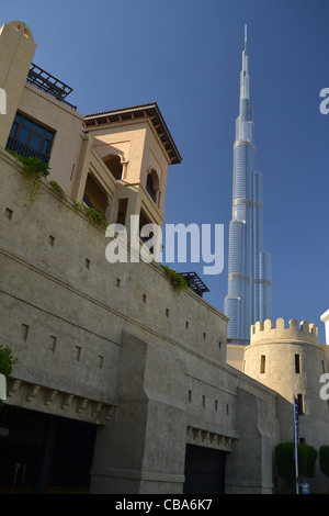 World's tallest building Burj Khalifa and old buildings, Dubai, United Arab Emirates - Stock Image