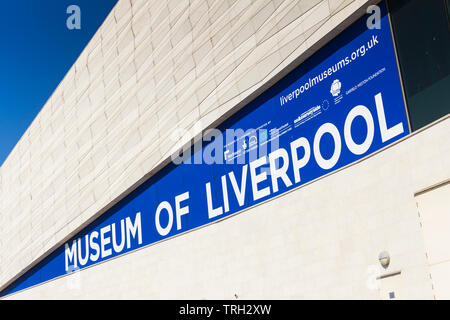 Museum of Liverpool sign on the building exterior, crediting various UK regional, Heritage Lottery Fund and European development funds for the project - Stock Image