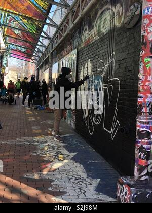 Graffiti artist in Boston, USA - Stock Image