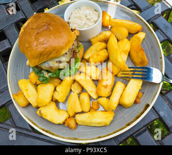 Classic Beefburger with chipped potatoes and chef's Burger Sauce - Stock Image