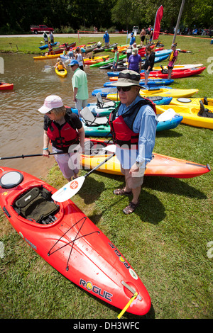 Two seniors attending a public kayaking event on a lake in Bella Vista, Arkansas, USA. - Stock Image