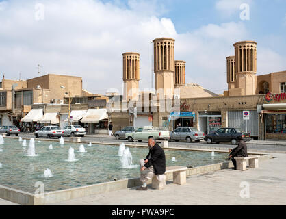 Yazd, Iran - March 7, 2017 : Windcatchers in Amir Chakhmaq square. Wind tower is a traditional Persian architectural element to create natural ventila - Stock Image