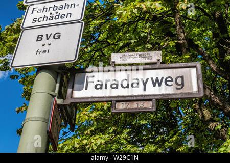 Berlin-Dahlem. Faradayweg road sign - street named after Michael Faraday, Physicist & Chemist - Stock Image