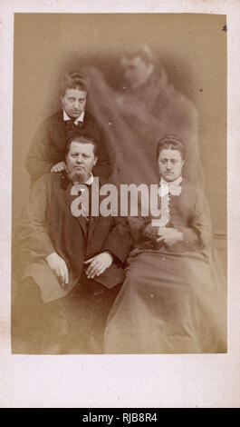 Small-format spirit photograph by Edouard Buguet of 5, Boulevard Montmartre, Paris showing a family group - Woman with her husband and her sister visited by a spirit of a dead relative. - Stock Image