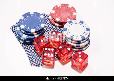 Gambling devices used in many games of chance cards, casino dice and betting tokens - Stock Image