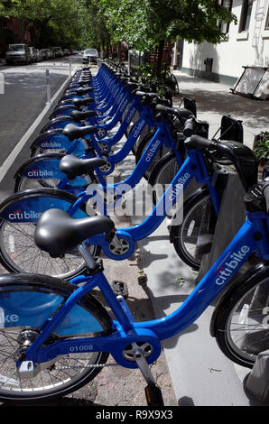 Citi bikes ride share bicycles parked in the Chelsea section of Manhattan - Stock Image