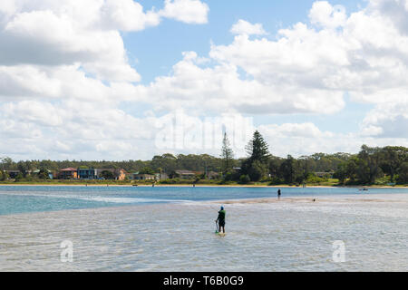 Crowdy Head, NSW, Australia-April 21, 2019: Fishermen enjoying the sunny weather in the small fishing village of Crowdy Head, famous for the breakwall - Stock Image