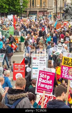 Protestors at Trafalgar Square demonstrate against the state visit of Donald Trump - Stock Image
