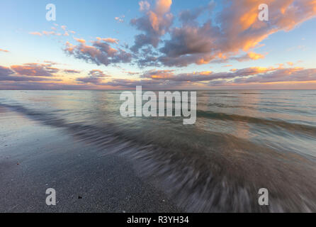 Sunset clouds over the Gulf of Mexico on Sanibel Island in Florida, USA - Stock Image