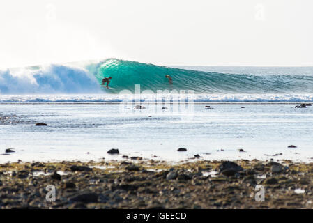 7th June 2017; Desert Point, Lombok, Indonesia.; Surfers from around the world enjoy the extreme swell of tube waves - Stock Image