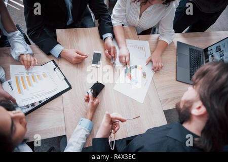 Working environment and discussion of a new project. Concept picture of economy, and money - Stock Image