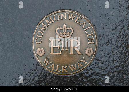 Commonwealth Walkway marker on a Glasgow pavement, Scotland, UK - Stock Image