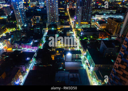 Manila, Philippines - November 11, 2018: Night view of the illuminated streets of the Malate district from above on November 11, 2018 in Metro Manila, - Stock Image