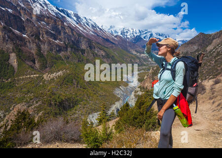 Closeup Beautiful Woman Traveler Backpacker Mountains Path.Young Girl Looks Horizon Take Rest.North Summer Snow - Stock Image