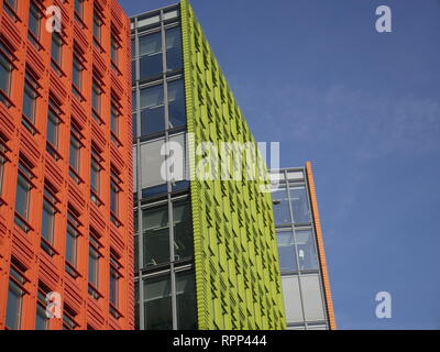 High rise coloured office buildings near central St Giles church, designed by the Italian architect Renzo Piano. - Stock Image