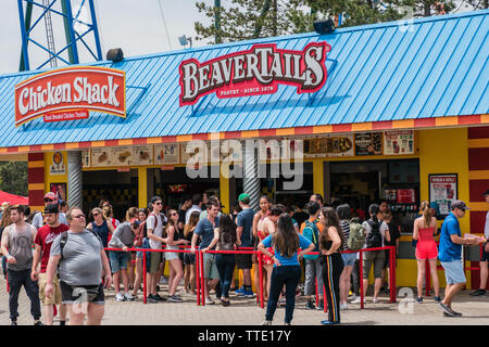 beavertails is a canadian pastry stand chain selling fried dough pastries that resemble a beaver's tail - Stock Image