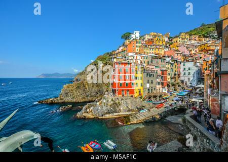 The colorful fishing village of Riomaggiore Italy, part of the Cinque Terre on the Italian Riviera Ligurian Coast - Stock Image