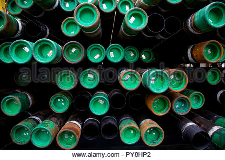 Stack of pipes with green lids - Stock Image
