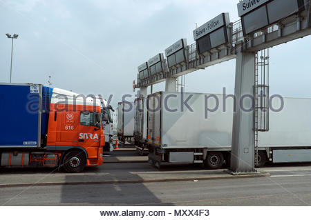 Trucks waiting to board the Eurotunnel freight shuttle train at Calais/Coquelles, northern France. - Stock Image