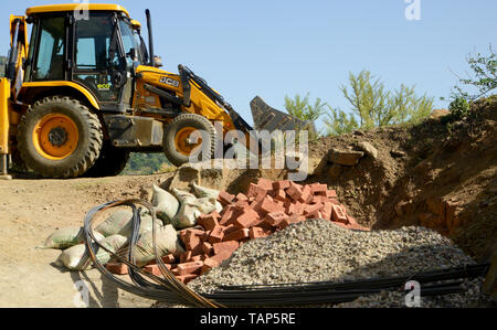 The yellow Bulldozer on the construction of hill highway - Stock Image