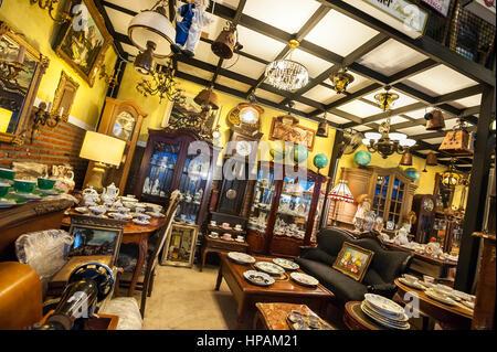 Antique shop interior at the Ratchada Train Market, Bangkok - Stock Image