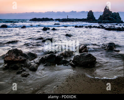 Long Exposure photograph of waves lapping rocks in rough seas in Cyprus - Stock Image