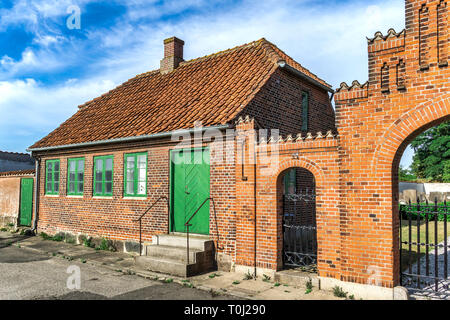 Characteristic small guardhouse in front the old Jewish cemetery in the former fortress town in the eastern part of Jutland - Fredericia, Denmark. - Stock Image