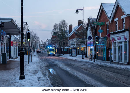 Fleet, Hampshire, UK. 2nd Feb, 2019. Heavy overnight snow followed by a sharp frost made for a difficult early morning for pedestrians and motorists. Image: Ambulances continued to operate despite the road conditions. Credit: Images by Russell/Alamy Live News - Stock Image