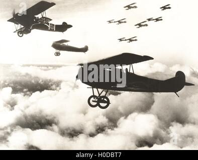 German biplanes flying above the clouds - Stock Image
