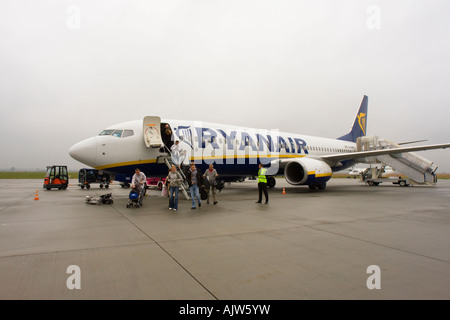 Passengers disembarking from Ryanair plane on airport tarmac at Jasionka Airport, Rzeszow, Poland - Stock Image