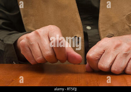 Playing flamenco rhythm with the knuckles of the hands. Spain. Europe - Stock Image