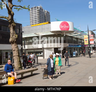 People shopping in pedestrianised street in Regent Street, town centre of Swindon, Wiltshire, England, UK - Stock Image