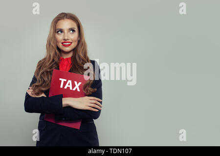 Business woman with red taxes report on gray banner background. Businesswoman in black suit portrait - Stock Image