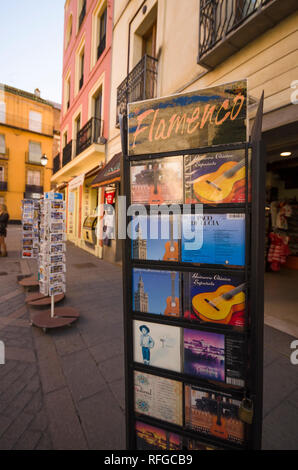 Display stand with Flamenco music CD's. in street in Seville, Andalusia, Spain. - Stock Image