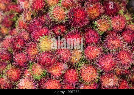 Pile of Rambutans at the Maeklong Railway Market, Thailand. - Stock Image