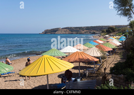 Sandy beach with colorful umbrellas - Stock Image
