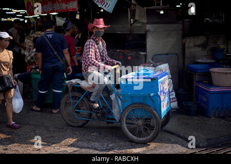 Ice cream vendor selling from a bicycle cart - Stock Image