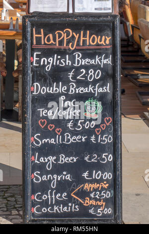 A Happy Hour Bar Chalk Board Menu ,Advertising Drinks And Breakfast In English Outside A Restaurant In Albufeira Algarve Portugal - Stock Image
