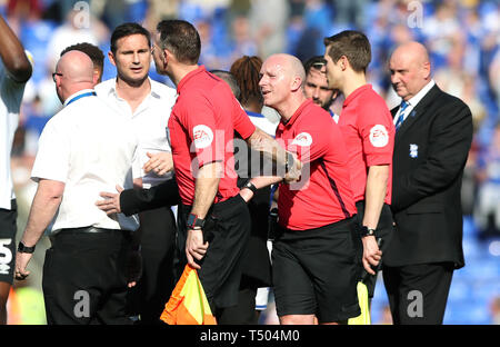 A match official pulls referee Simon Hooper away from Derby County manager Frank Lampard (second left) after exchanging words following the Sky Bet Championship match at St Andrew's Trillion Trophy Stadium, Birmingham. - Stock Image