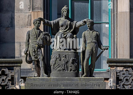 The statue of Caledonia crowning her sons,a Highland reaper and a ploughboy, on what was once the headquarters of the Highland Society in Edinburgh. - Stock Image