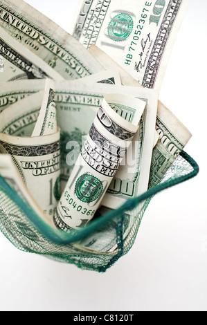 dollars in fishnet - Stock Image