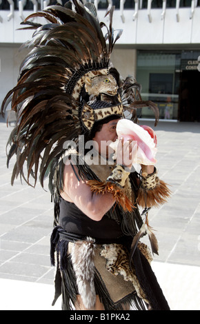 Mexican Man Blowing into a Shell at an Aztec Celebration in the National Museum of Anthropology Chapultepec Park - Stock Image