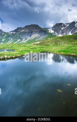 Small mountain lake in Greina valley, Tessin, Switzerland - Stock Image