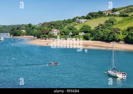 3 June 2018: Salcombe, Devon, UK - Salcombe and the Kingsbridge Estuary Devon UK, with ferry crossing over. - Stock Image